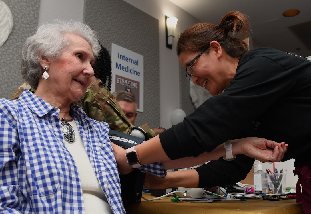 Stacy Latack, 81st Medical Group disease management nurse, checks the blood pressure of Ellie Warren, widow of U.S. Air Force retired Master Sgt. Robert Warren, during the 81st Medical Group Health Expo inside the Keesler Medical Center at Keesler Air Force Base, Mississippi, Oct. 4, 2019. The 81st MDG hosted the walk-in event which included screenings for multiple types of cancer and chronic diseases in honor of Breast Cancer Awareness Month. (U.S. Air Force photo by Kemberly Groue)