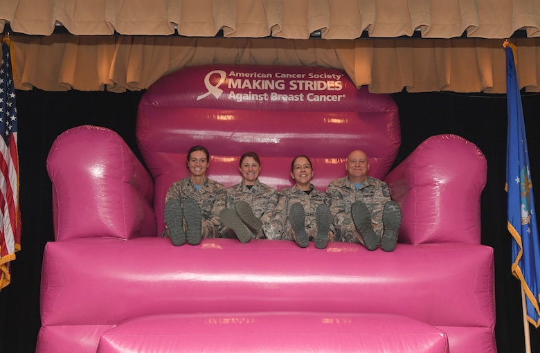 Keesler leadership poses for a photo during the 81st Medical Group Health Expo inside the Keesler Medical Center at Keesler Air Force Base, Mississippi, Oct. 4, 2019. The 81st MDG hosted the walk-in event which included screenings for multiple types of cancer and chronic diseases in honor of Breast Cancer Awareness Month. (U.S. Air Force photo by Kemberly Groue)