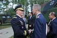 U.S. Army Reserve Brig. Gen. Michael T. Harvey, commander of the 7th Mission Support Command, shakes hands with Lt. Gen. Martin Schelleis, German Force Base Inspector General, after a Multinational Civil-Military Cooperation Command re-flagging ceremony held in Nienburg, Germany, Sept. 30, 2019. Members of the 361st Civil Affairs Brigade, 7th MSC, attended the ceremony in support of their long-standing partnership with the Multinational CIMIC Command.