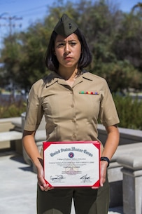 U.S. Marine Corps Cpl. Victoria Fontanelli, an administrative specialist with 13th Marine Expeditionary Unit Command Element, holds her diploma after completing Corporals Course, at Marine Corps Base Camp Pendleton, Calif., Oct. 4, 2019.