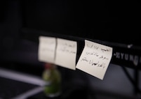 Personal reminders and appointments written by Airman 1st Class Aws Hussein, 66th Comptroller Squadron financial management technician, stick to his computer on Hanscom Air Force Base, Massachusetts, Oct. 10. Originally from Baghdad, Iraq, Hussein served as in interpreter along side U.S. troops from 2007 to 2011 before immigrating to San Antonio, Texas with his wife and two children.