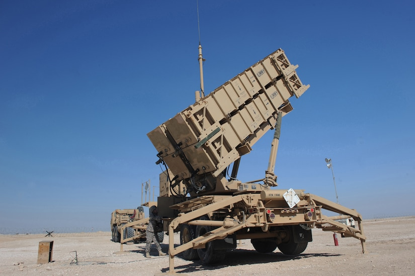 A soldier performs operations on missile launch system.