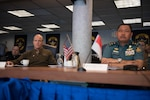 Vice Adm. Bill Merz, commander, U.S. 7th Fleet, and Rear Adm. Didik Setiyono, assistant chief of the Indonesian Navy for Operations, is briefed during staff talks aboard the U.S. 7th Fleet flagship, USS Blue Ridge (LCC 19) October 11, 2019. The Indonesian Navy's visit to U.S. 7th Fleet headquarters is highlighted by this year's marking of the 70th anniversary of diplomatic ties between the United States and Indonesia.