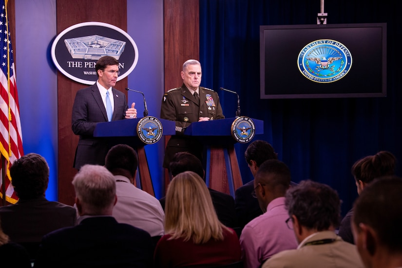 Defense Secretary Dr. Mark T. Esper speaks from a lectern, as Army Gen. Mark A. Milley stands next to him at an identical one.