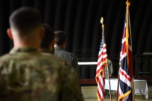 48th Fighter Wing Airmen stand at attention during an Air Force Achievement Medal presentation ceremony at Royal Air Force Lakenheath, England, Oct. 11, 2019. Staff Sgt. Patrick Theran Jr., Senior Airman Jacob Doyle and Airman 1st Class Jimmy Keenright Jr., all assigned to the 748th Aircraft Maintenance Squadron, stopped a potentially devastating brake fire from taking the life of the aircrew on board and from destroying a 34 million dollar aircraft, F-15C Eagle, April 29, 2019. (U.S. Air Force photo by Airman 1st Class Madeline Herzog)