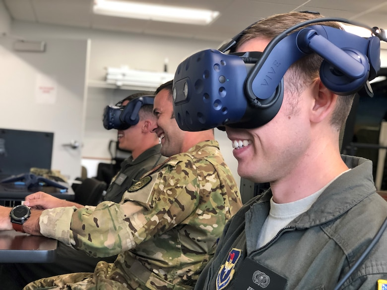 Students and an instructor pilot with the 23rd Flying Training Squadron's Specialized Undergraduate Pilot Training - Helicopter Class 20-02 take part in a virtual reality sortie at Fort Rucker, Ala., Oct. 9, 2019.  The class incorporated VR into the experimental curriculum on day one of training, transforming the learning environment. The class graduated Oct. 11, six weeks earlier than normal. (U.S. Air Force courtesy photo)