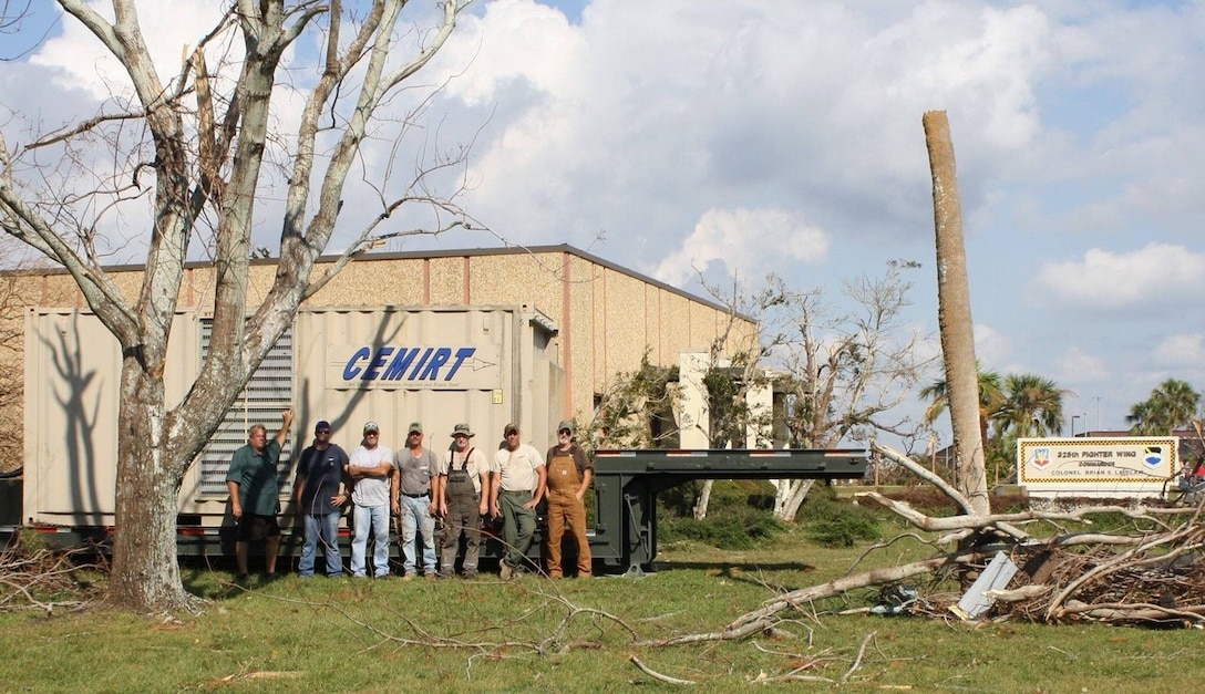 Members of CEMIRT, seen here in front of the 325th Fighter Wing building at Tyndall AFB, hooked up 17 generators for a total of 3.4 megawatts of power in the first nine days post-Hurricane Michael.