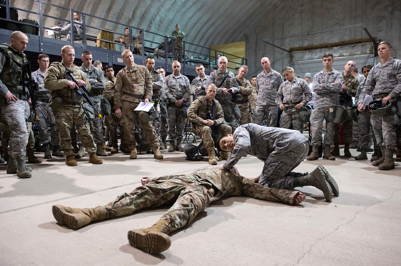 U.S. Air Force Staff Sgt. Rafael Ibarra, a 673rd Medical Group medic, performs a simulated casualty assessment while instructing Tactical Combat Casualty Care during exercise Polar Force 20-1, at Joint Base Elmendorf-Richardson, Alaska, Oct. 7, 2019. Designed to test mission readiness, Polar Force is a two-week exercise that develops the skills required to face and overcome adverse scenarios. (U.S. Air Force photo by Alejandro Peña)