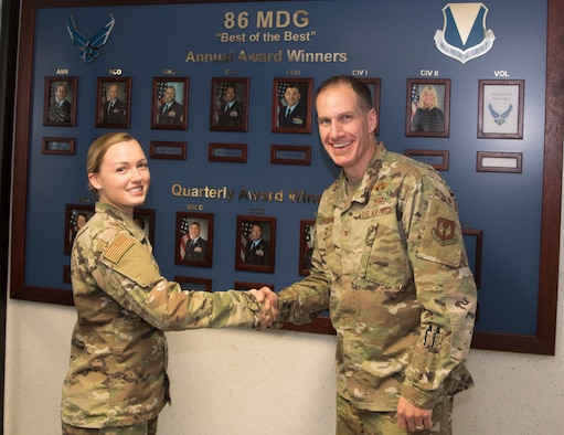 U.S. Air Force Col. Matthew S. Husemann, 86th Airlift Wing vice commander, poses for a photo with Senior Airman April VanHorn, 86th Aerospace Medical Squadron medical technician, to recognize her as Airlifter of the Week at Ramstein Air Base, Germany, Oct. 11, 2019. VanHorn received the award after streamlining several processes prior to a group inspection and for her proactiveness in providing first response action to an unconscious individual during a trip to Oktoberfest. (U.S. Air Force photo by Senior Airman Kristof J. Rixmann)