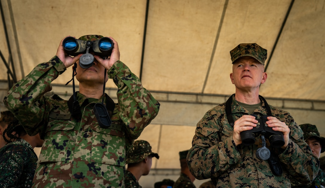 """U.S. Marine Maj. Gen. Paul J. Rock Jr., right, and Japan Ground Self-Defense Force Maj. Gen. Shinichi Aoki observe an amphibious exercise during KAMANDAG 3 at Katungkulan Beach, Marine Barracks Gregorio Lim, Philippines, Oct. 12, 2019. KAMANDAG helps participating forces maintain a high level of readiness and responsiveness, and enhances combined military-to-military relations, interoperability, and multinational coordination. Rock Jr. is the commander of 3rd Marine Expeditionary Brigade and the deputy commander of III Marine Expeditionary Force. Aoki is the commander of the JGSDF Amphibious Rapid Deployment Brigade. KAMANDAG is an acronym for the Filipino phrase """"Kaagapay Ng Mga Manirigma Ng Dagat,"""" which translates to """"Cooperation of the Warriors of the Sea,"""" highlighting the partnership between the U.S. and Philippine militaries."""