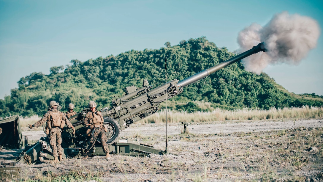 U.S. Marines with Alpha Battery, Battalion Landing Team 3/5, 11th Marine Expeditionary Unit, fire an M777 towed 155 mm howitzer at Colonel Ernesto Ravina Air Base, Philippines, during exercise KAMANDAG 3, Oct. 13, 2019. KAMANDAG helps participating forces maintain a high level of readiness and responsiveness, and enhances combined military-to-military relations, interoperability, and multinational coordination.