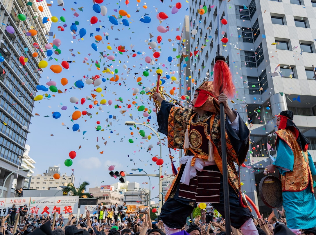 A ceremonial actor portraying the king of the West signals the start of the 49th annual Naha Great Tug-of-War Festival, Oct. 13, 2019 at Naha, Okinawa, Japan. The event symbolizes a struggle between warring factions during the reign of the Ryukyu Kingdom on Okinawa. The event is considered the world's largest tug-of-war, using a 200-meter-long, 43-ton rope.