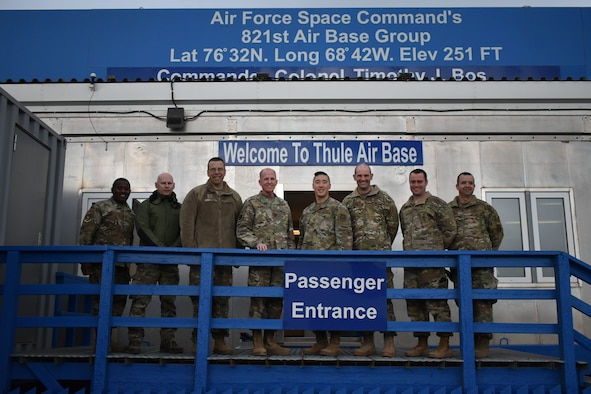 General Stephen W. Wilson, center, vice chief of staff of the Air Force, poses for a photo with American and Danish base leadership Oct. 1, 2019 at Thule Air Base, Greenland. During his visit Wilson learned about how Airmen at Thule AB operate in a harsh arctic environment while supporting three diverse mission sets: tactical warning of potential ballistic missile attacks, providing space situational awareness by tracking manmade objects in orbit, and satellite command and control. (U.S. Air Force courtesy photo)