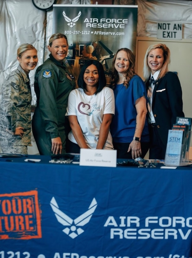 Several 932nd Airlift Wing members and alumni volunteered to speak to high school girls and teachers at the Girls in Aviation Day held Oct. 4, 2019 at the St. Louis Downtown Airport.  Staff Sgt. Jennifer Deimund, Tech Sgt. Stephanie Enders, Tech Sgt. Stephanie McCloud, Tech Sgt. April Tarbill and retired C-40 pilot Lt. Col. Tracy Vazanna helped answer questions about aviation, and their unique military experiences serving America in the Air Force Reserve's 932nd Airlift Wing, located at Scott Air Force Base.  The Illinois unit flies the C-40C distinguished visitor aircraft.  (Photo submitted)