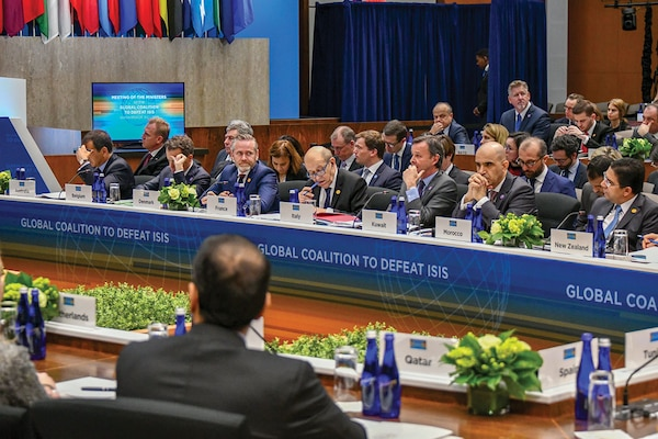 In February 2019, foreign ministers listen to U.S. Secretary of State Michael R. Pompeo deliver opening remarks at the Meeting of the Ministers of the Global Coalition to Defeat ISIS. (U.S. State Department/ Ron Pryzyucha)