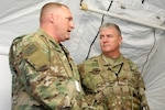 South Dakota Army National Guard Adjutant General Maj. Gen. Jeffrey Marlette, right, talks with Lt. Col. Jason Campbell, command judge advocate with the 196th Maneuver Enhancement Brigade, at a simulated wartime exercise Sept. 25-Oct. 12 in Joint Base Lewis-McChord, Wash.