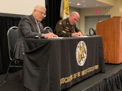 Retired Gen. Carter Ham, president and CEO, Association of the United States Army, and Maj. Gen. Frank Muth, commanding general, U.S. Army Recruiting Command, sign a memorandum of understanding during the AUSA Conference in Washington, D.C. today. This event formalizes a partnership between the two organizations to establish a cooperative framework for outreach.