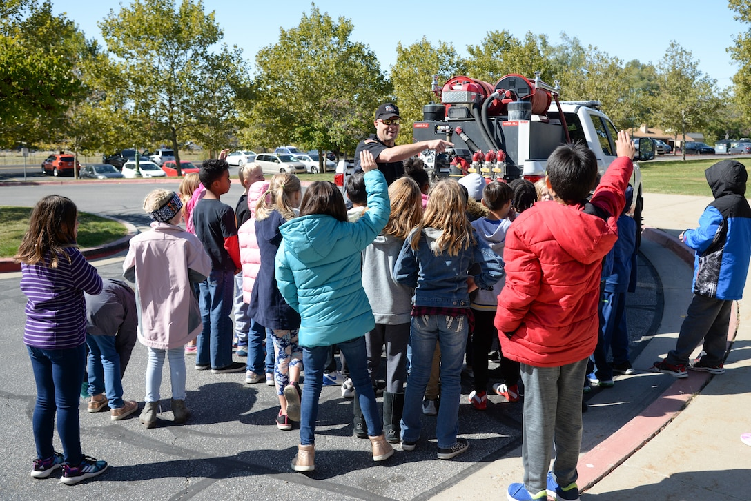 Doran Smith, Fire and Emergency Services at Hill Air Force Base, Utah, talks to Hill Field Elementary students about fire safety Oct. 10, 2019, in front of the department's new heavy-brush truck. This was one of the numerous outreach events base firefighters sponsored for Fire Prevention Week Oct. 6-12. (U.S. Air Force photo by Cynthia Griggs)