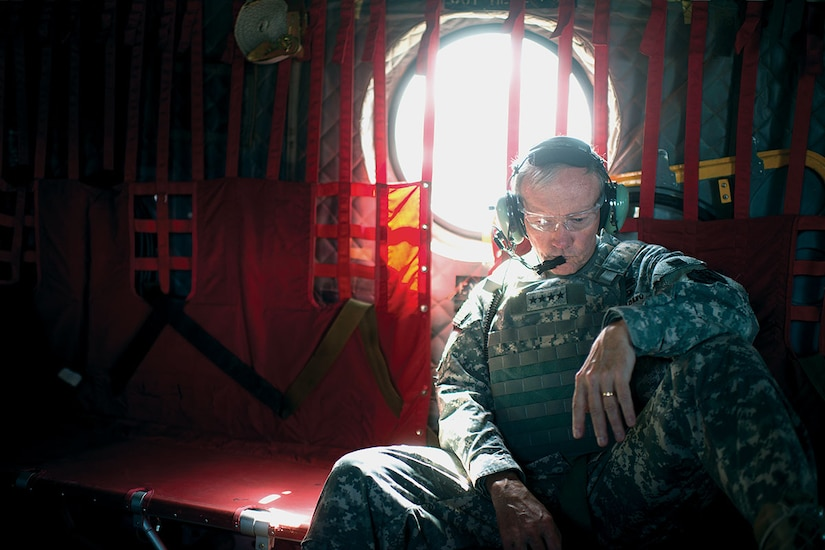 Army Gen. Martin E. Dempsey, chairman of the Joint Chiefs of Staff, aboard a CH-47 traveling from Bagram to Kabul, Afghanistan, for meeting with ISAF, CENTCOM, State Dept. and Afghanistan military leadership Aug. 20, 2012. DOD photo by D. Myles Cullen