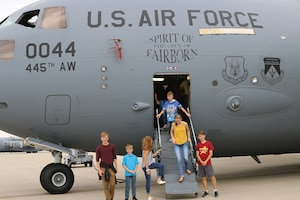 Citizen Airmen from the 445th Airlift Wing, families and friends enjoy a day of food and fun at the wing's annual family day picnic, Sept. 8. 2019 at Bass Lake. Participants enjoyed the day fishing, playing volley ball, corn hole and various activities. A C-17 Globemaster III static display was also available for tours. A DJ was also on hand for entertainment. And various helping agencies provided useful information to Airmen and their families. Food for the event was provided by the Wright-Patterson Air Force Base United Service Organizations (USO).