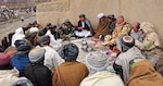 In August 2009, Afghan locals review ballots before voting in the heavily anticipated Afghanistan elections in Barge Matal. Elections are frequently a priority of the international community in post-conflict and even in conflict-afflicted states. (U.S. Army/ Christopher W. Allison)