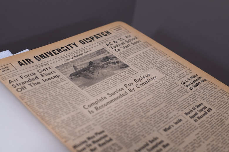 An original copy of the 'Air University Dispatch' sits on display before AU Library employees digitize it, Aug. 22, 2019, on Maxwell Air Force Base, Alabama. The library is currently working on digitizing all copies of the dispatch they have in possession, in addition to more than 2,500 linear feet of other current and historic research and documents.