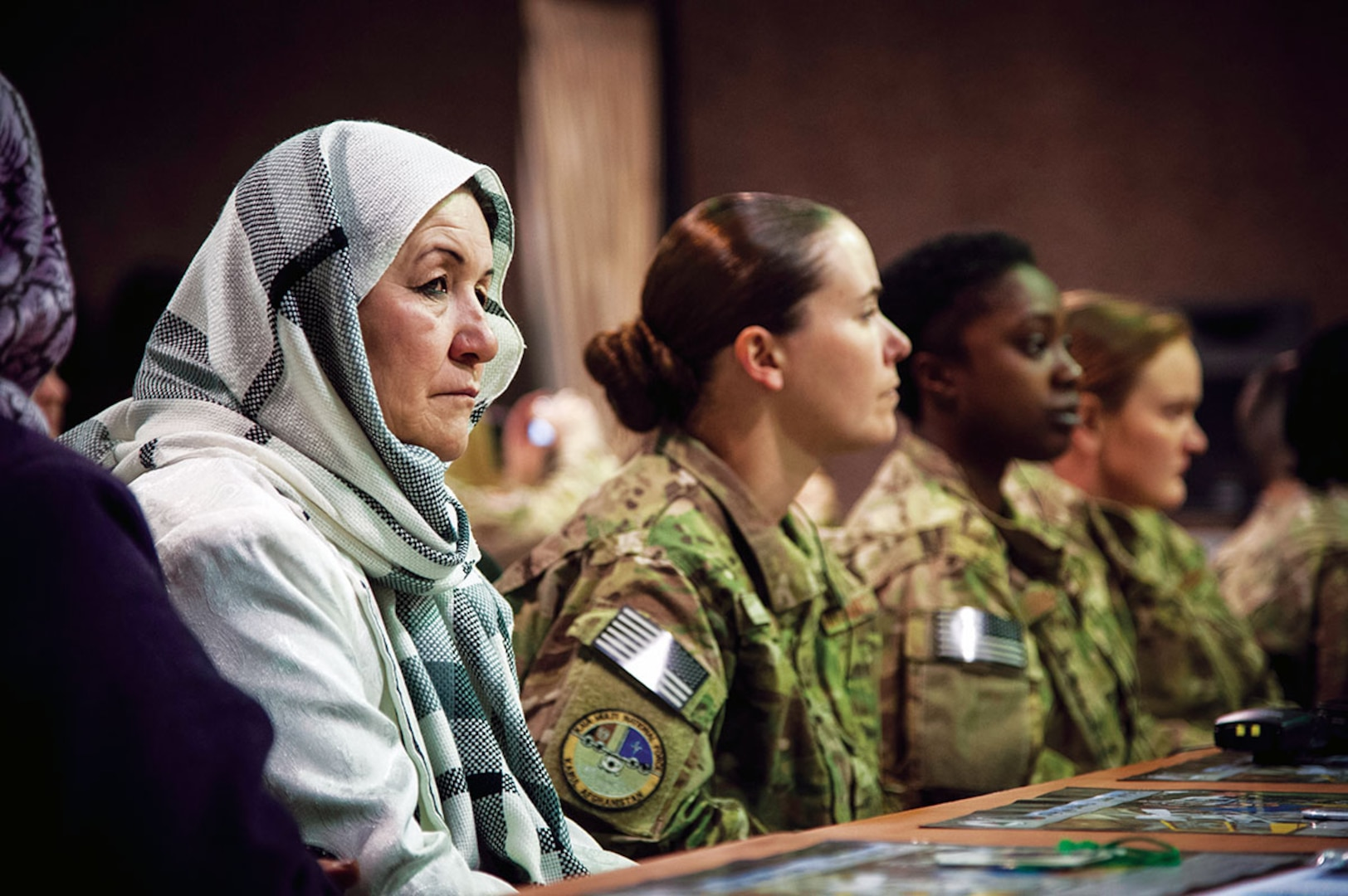 Women from the Afghan Air Force and International Security Assistance Force Afghanistan listen to presentations made during an International Women????????s Day celebration at Kabul International Airport March 7, 2013. The celebration highlighted the contributions afghan women make towards building a better and stronger Afghan Air Force. (U.S. Air Force Photo By: SSgt Dustin Payne, ISAF HQ Public Affairs)