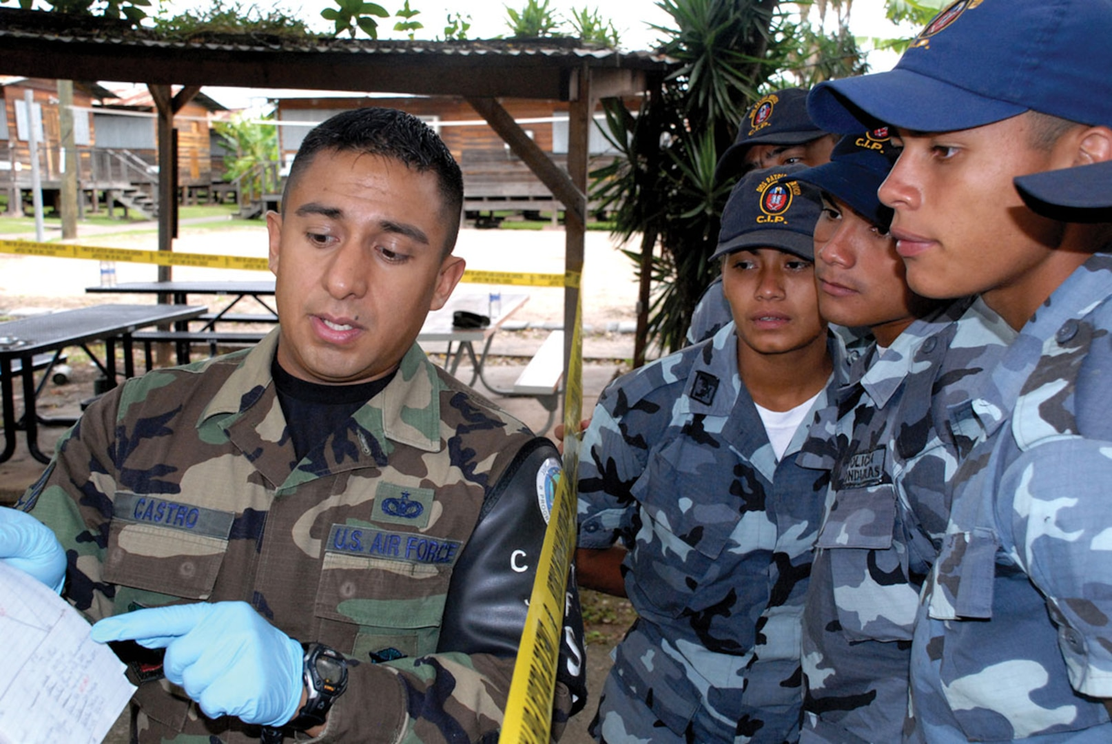 Staff Sgt. Edgar Castro, joint security forces, explains crime scene processing paperwork to students from the La Paz Police Academy during a training course here. The crime scene processing class is one in a series of classes taught this year, with other lessons involving handcuff procedures, high-risk traffic stops and riot control. (U.S. Air Force photo/Tech. Sgt. Sonny Cohrs)