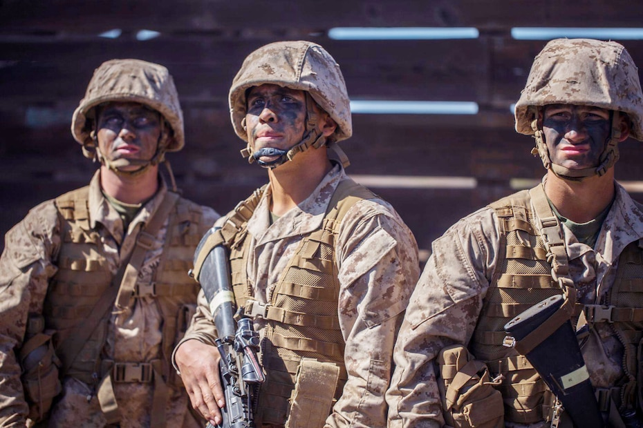 Recruits with Fox Company, 2nd Recruit Training Battalion, analyze an obstacle during the crucible at Marine Corps Base Camp Pendleton, California Oct. 2, 2019.