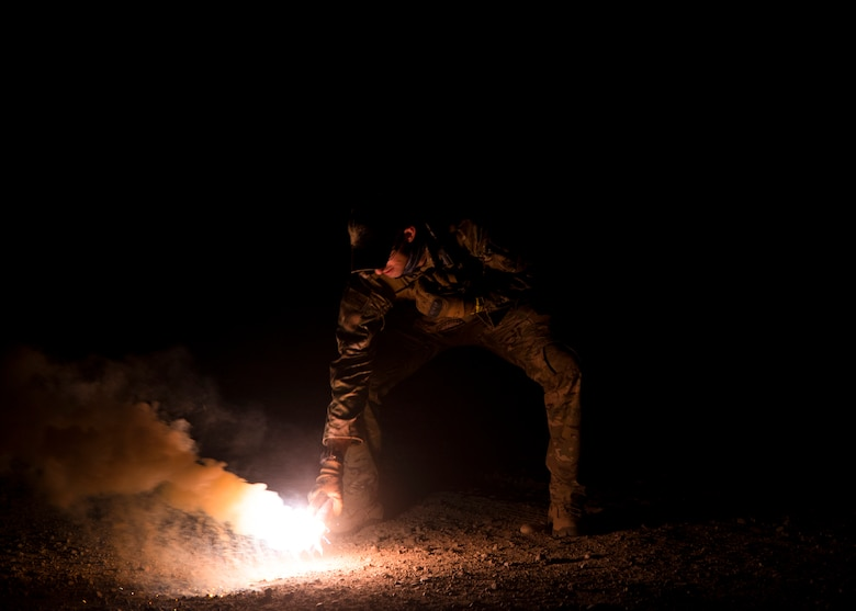Staff Sgt. David Chorpeninng, 366th Fighter Wing survival, evasion, resistance and escape specialist, pops the illumination end of a MK-124 marine smoke and illumination signal Sept. 26, 2019, at Saylor Creek Bombing Range, Idaho.
