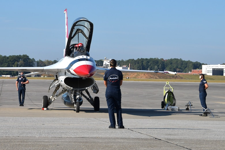 U.S. Air Force Thunderbirds aircrew conduct pre-flight checks at Dobbins Air Reserve Base, Ga. on Oct. 11, 2019. Tracey Pendley, this year's Georgia Teacher of the Year and Hometown Hero, flew with the Thunderbirds. (U.S. Air Force photo/Airman Kendra A. Ransum)