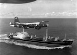 A U.S. Navy P2V Neptune flies over a Soviet freighter Oct. 27, 1962, during the height of the blockade during the Cuban Missile Crisis. National Archives and Records Administration photo