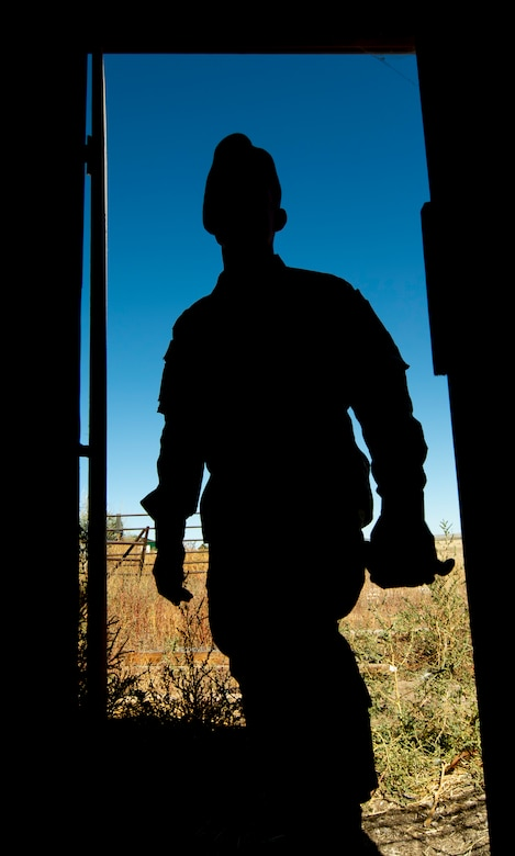 Tech. Sgt. Michael Jones, 50th Space Wing Inspector General's office wing exercise section chief, walks into a chicken coop at his farm in Ellicott, Colorado, Sept. 30, 2019. Jones began working on the farm to strengthen his resilience when he returned from a nine-month deployment to Guantanamo Bay Naval Base, Cuba. (U.S. Air Force photo by Airman 1st Class Jonathan Whitely)
