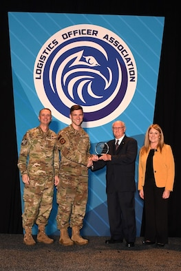 Retired Air Force Col. James Hass presents the MacDill Lightning Chapter the Logistics Officer Association's (LOA) 2019 Small Chapter of the Year award to Air Force 2nd Lt. Matt Moskowitz, MacDill Air Force Base's Lightning Chapter vice president assigned to the 6th Logistics Readiness Squadron during the LOA Symposium Oct. 10 in Oklahoma City, Oklahoma. U.S. Air Force Lt. Gen. Warren Berry, deputy chief of staff for Logistics, Engineering and Force Protection, left, and Carol Howitz, president of the Logistics Officer Association, join them. (Courtesy photo)
