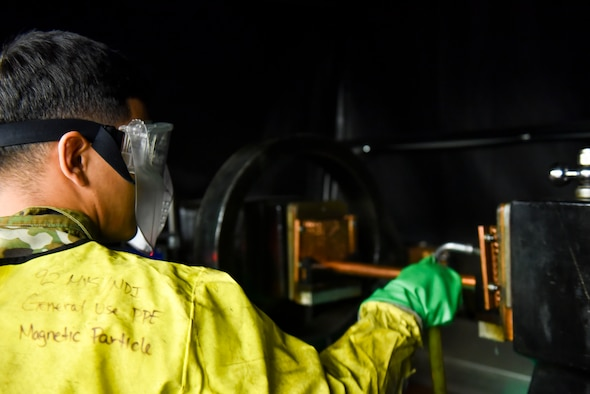 U.S. Air Force Airman 1st Class Patrick Torres, 92nd Maintenance Group non-destructive inspection technician, prepares a rod to magnetically test a product on Fairchild Air Force Base, Washington, Sept. 5, 2019. Magnets are one of six methods used to detect cracks and weakened spots on aircraft parts, potential issues that other maintenance career fields would not be able to identify without taking the KC-135 apart. (U.S. Air Force photo by Airman Kiaundra Miller)