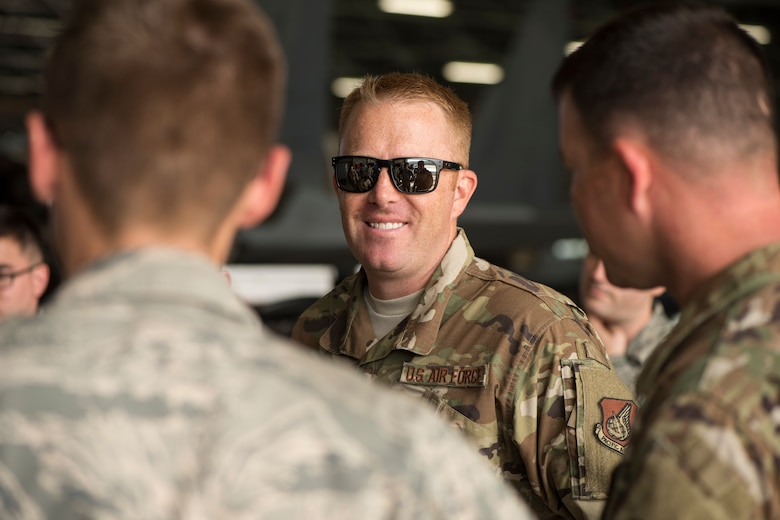U.S. Air Force Master Sgt. Kyle Dunn, the 13th Aircraft Maintenance Unit F-16 Fighting Falcon production superintendent, smiles while speaking with his fellow Airmen during an aviation training relocation at Komatsu Air Base, Japan, Sept. 30, 2019. Approximately 90 Misawa Airmen and six U.S. Air Force F-16 Fighting Falcons traveled to Komatsu AB in support of facilitating bilateral training sorties while enhancing tactical skillsets, friendships and alliances with their host nation partners. (U.S. Air Force photo by Senior Airman Collette Brooks)
