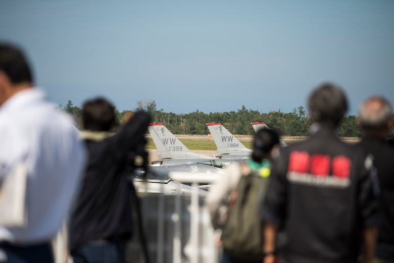 Local Komatsu media outlets take photos of various U.S. Air Force F-16 Fighting Falcons during an aviation training relocation at Komatsu Air Base, Japan, Oct. 1, 2019. Mainichi, Hokuriku Chunichi, Hokko Ku and other local press representatives attended the bilateral training to photograph and film incoming F-16s increasing the visibility and knowledge of the week-long exercise. The F-16s are assigned to the 35th Aircraft Maintenance Unit at Misawa AB, Japan. (U.S. Air Force photo by Senior Airman Collette Brooks)