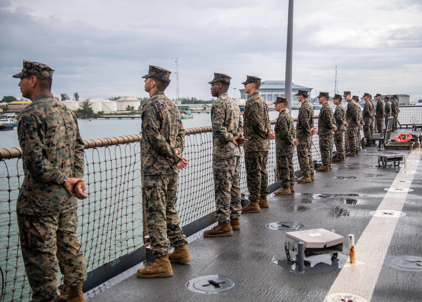MAURA, Brunei (Oct. 10, 2019) Marines, assigned to the 11th Marine Expeditionary Unit (MEU), man the rails of the amphibious dock landing ship USS Harpers Ferry (LSD 49) as the ship arrives in Maura, Brunei, for Cooperation Afloat Readiness and Training (CARAT) Brunei. Harpers Ferry and elements of the 11th MEU are ashore in Brunei to perform day and night training in an urban environment and to enhance interoperability and partnership between the U.S. and Brunei during CARAT Brunei 2019.