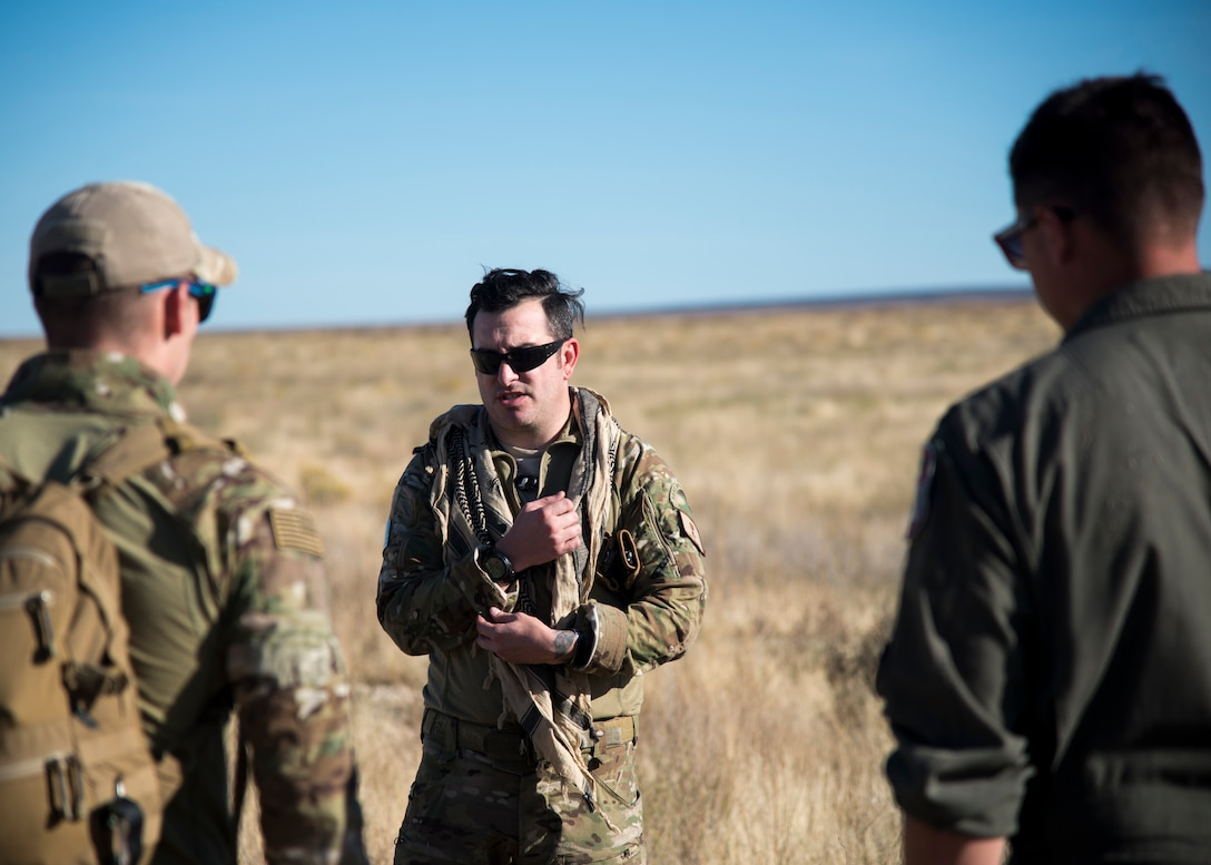 Tech Sgt. Timothy Emkey, 366th Fighter Wing survival, evasion, resistance and escape specialist, explains what to look for when trying to evade the enemy's line of sight Sept. 26, 2019, at Saylor Creek Bombing Range, Idaho.