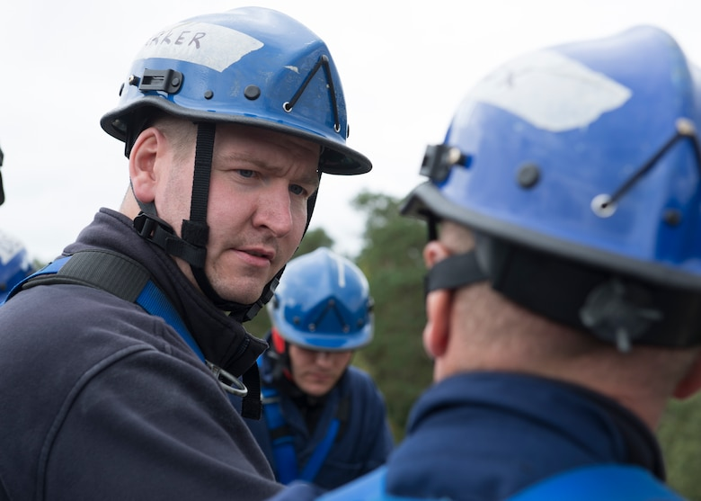 Adam Parker, a firefighter from the 423rd Civil Engineer Squadron, speaks with another student about their team's next move during Rescue Technician I Course near Ramstein Air Base, Germany, Oct. 10, 2019. The Rescue Technician I Course is open to firefighters from all branches of service as well as civilians.