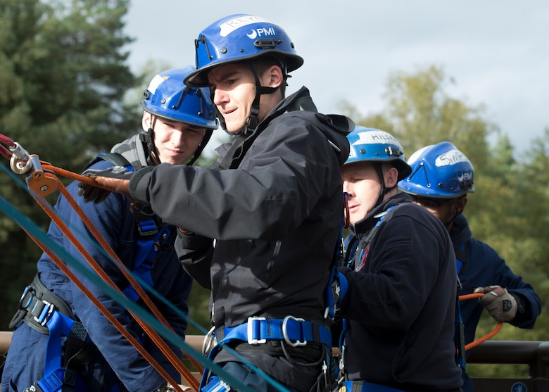 Airman 1st Class Ethan Revelle, a firefighter from the 86th Civil Engineer Squadron, pulls on a rope along with other students during Rescue Technician Course I Course near Ramstein Air Base, Germany, Oct. 11, 2019. Depending on the speed of the firefighters' pulls, their system can move slower or faster.