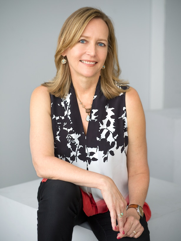 A photo of a seated woman, author Liza Mundy, CCH Scholar-in-Residence for 2020.