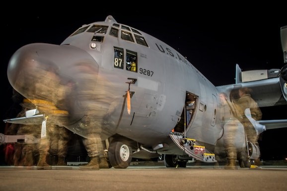 Photo of Airmen preparing a C-130 for flight.