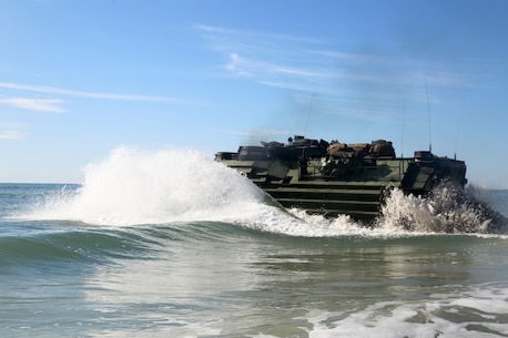 U.S. Marines with Assault Amphibious Vehicle Platoon, Battalion Landing Team, 2nd Battalion, 8th Marine Regiment, 26th Marine Expeditionary Unit, splash into the Atlantic Ocean off the coast of Camp Lejeune, N.C., Oct. 12, 2019. The 26th MEU is underway conducting a composite training unit exercise with the Bataan Amphibious Ready Group. (U.S. Marine Corps photo by Staff Sgt. Patricia A. Morris)