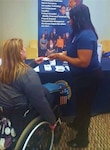 Dr. Alessia Payne speaks with potential employee at the Opportunities for Ohioans Job Fair on October 9th. The event was held at the Nationwide and Ohio Farm Bureau 4-H Center on the OSU Campus.