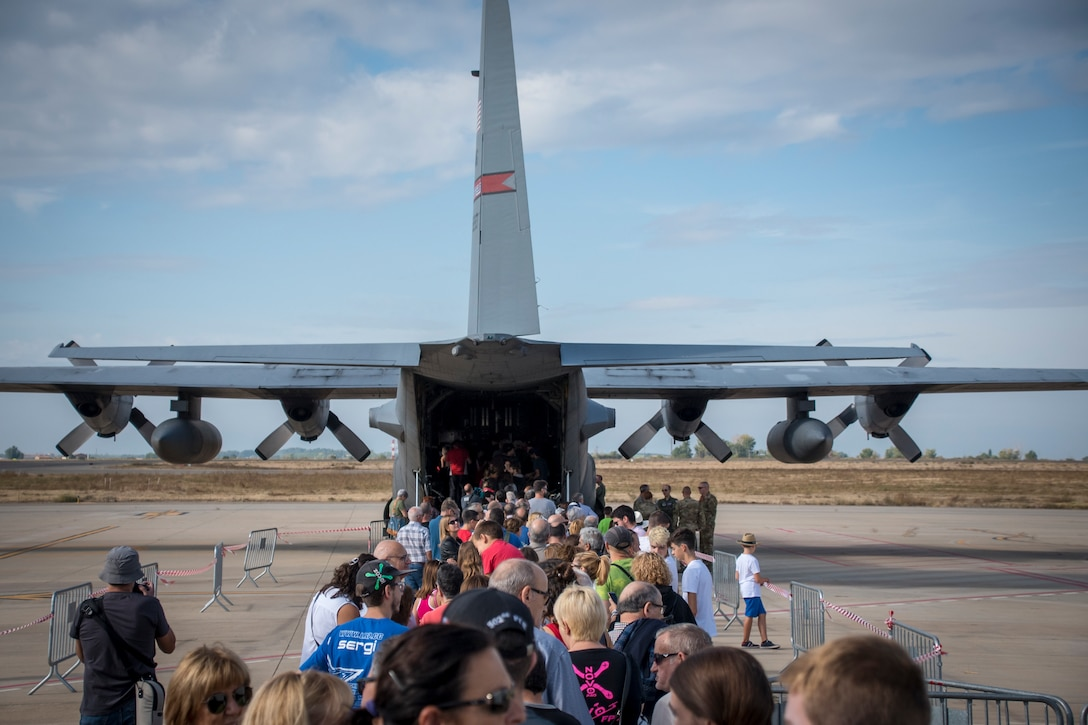 Photo of people waiting in line to tour the inside of a C-130