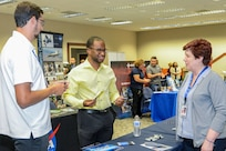 Arman Johnson speaks with a local business representative during a spouse employment job fair at the Airmen and Family Readiness Center, Edwards Air Force Base, California, Sept. 13.