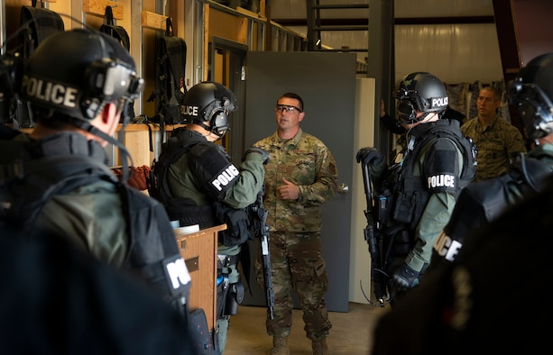 SCHRIEVER AIR FORCE BASE, Colo.—Staff Sgt. Jeremy Brown, 50th Security Forces Squadron response force leader, discusses tactics with Fountain Police Department's Rapid Response Team during an active shooter training exercise at the 50th SFS training facility, Schriever Air Force Base, Colorado, Oct. 9, 2019. The training served as an opportunity for both agencies to familiarize themselves with the techniques and procedures they follow when responding to threats. (U.S. Air Force photo by Staff Sgt. Matthew Coleman-Foster)