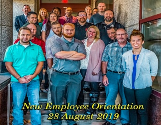 New associates pose for a group photo after attending New Employee Orientation Aug. 28 and 29 in the Building 20 Buckeye Room. The class included police officers, quality assurance specialist and staff accounts. Pictured (l-r) Matthew Archer, Louis Shotto, Kelly Lincoln, Robert Dotson, Rachael Davis.  2nd Row Kevin Houser, Robert Rickel.  3rd Row Todd Lott, Sherry Lott, Jerry Caylor, Jared Koscis. Back Row Griff Warren, Kristen Hershberger, Stephanie Avery, Harry White, Pam Carrico, Angel Martinez, Kevin Bellew and Arron Reeves.