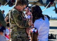 Airmen assigned to the 79th Rescue and 655th Aircraft Maintenance Squadrons are welcomed home by family and friends at Davis-Monthan Air Force Base, Arizona, Oct. 13, 2019. The Airmen were deployed supporting our mission abroad. (U.S. Air Force photo by Senior Airman Kristine Legate)